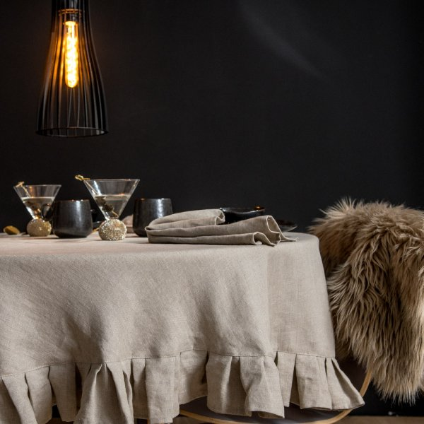 Round linen tablecloth in a natural shade