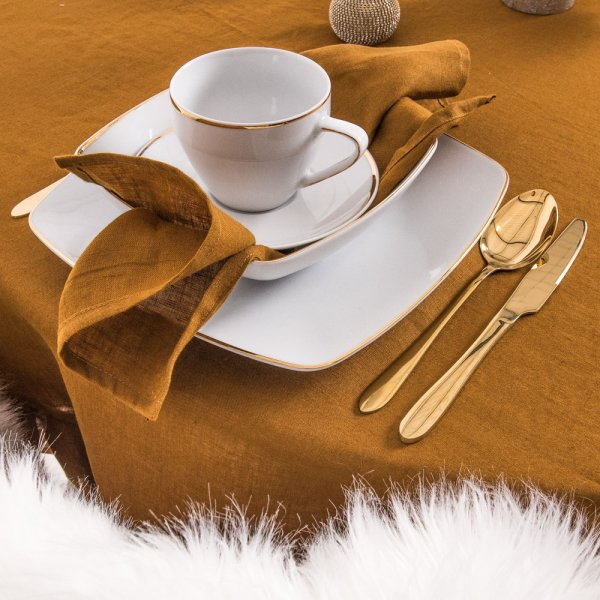 Round linen tablecloth in ochre