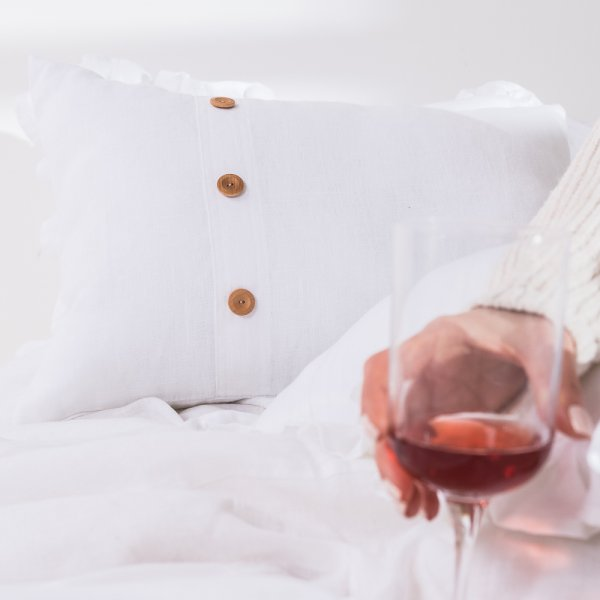 White linen bedspread with buttons