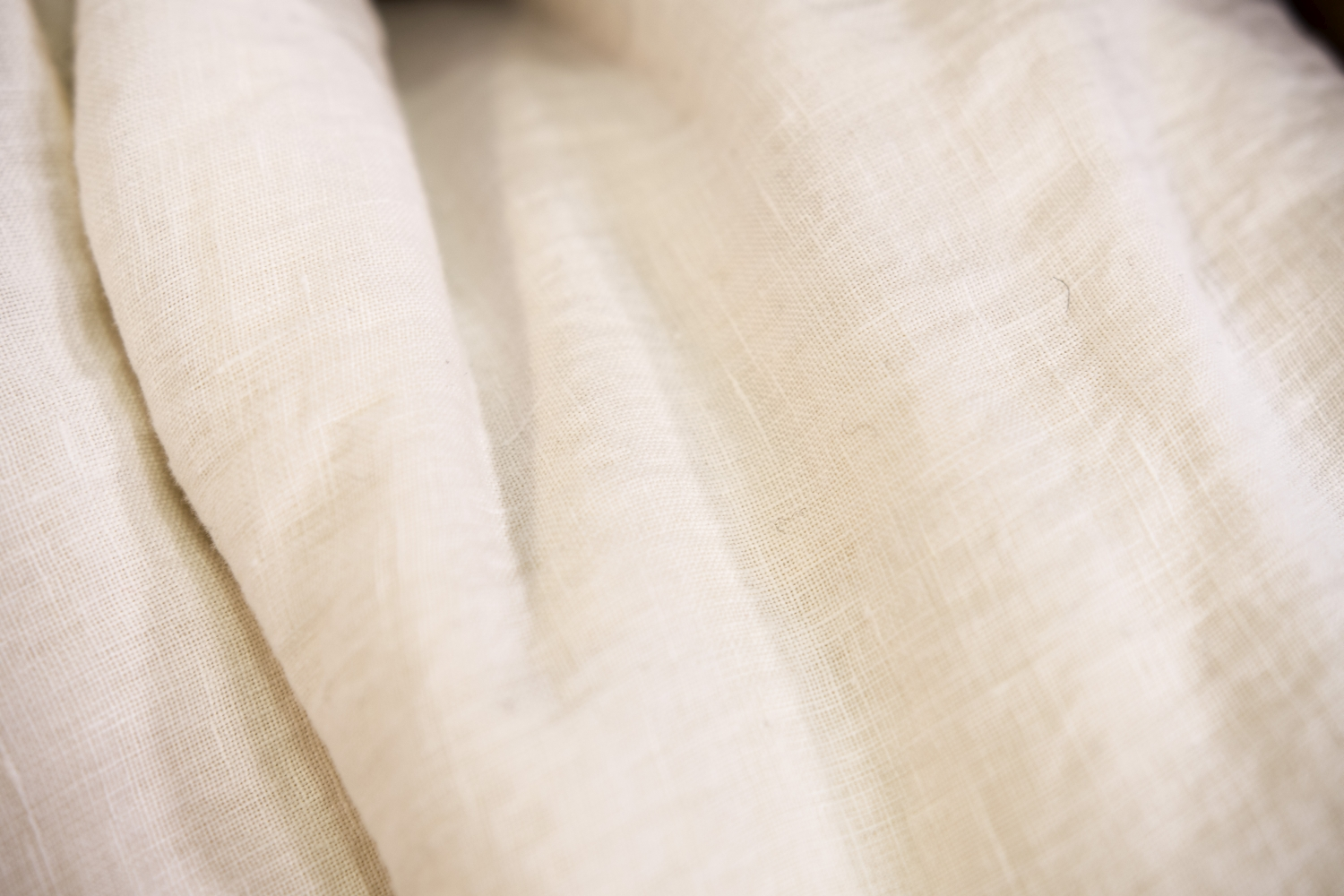 Soft, white linen bedding fabric.