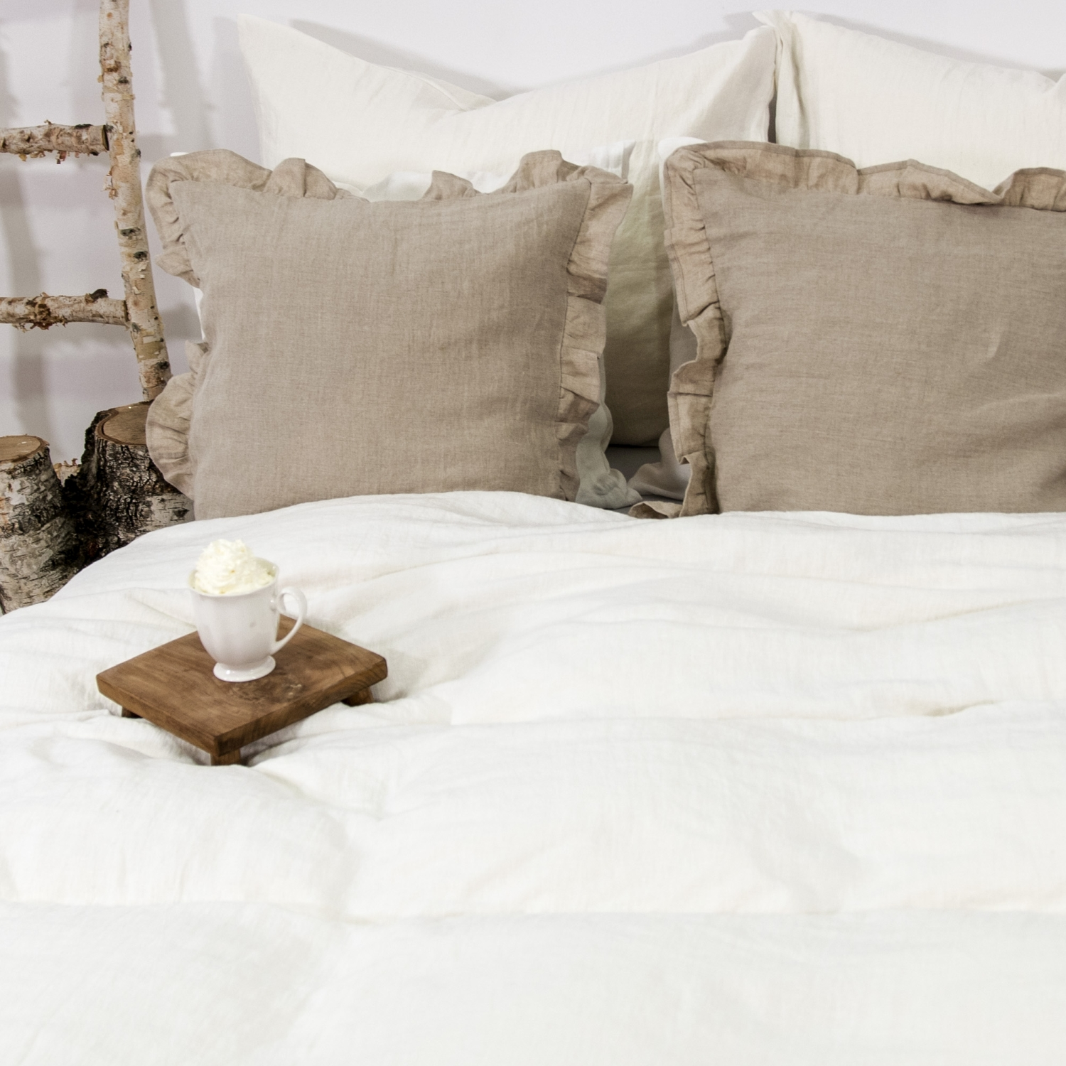 Soft white linen bedding.